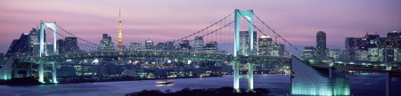 Rainbow Bridge with skyline in background at dusk, Tokyo, Japan